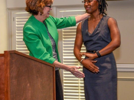 Octavia Frazile, right, is awarded the scholarship by Robyn Zimmerman.