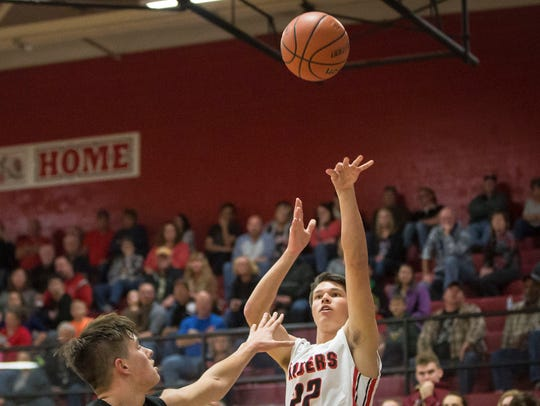 Wapahani's Drew Luce takes the shot during the game