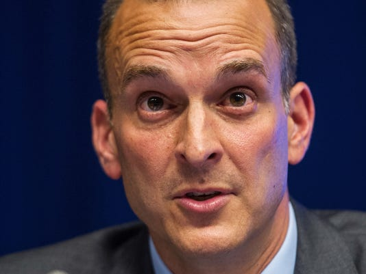 FILE - In this May 17, 2013, file photo, Travis Tygart, the head of the U.S. Anti-Doping Agency addresses, the media at the EU Council in Brussels. Tygart, the leader of the U.S. anti-doping effort, says nothing short of removing the Russian flag from this summer's Olympics would suffice if an upcoming report about Russian doping is as damning as expected. The World Anti-Doping Agency commissioned an investigation, being headed by Richard McLaren, into Russian doping following a New York Times story in May that detailed a state-run system that helped athletes get away with cheating and win medals at the Sochi Olympics in 2014. The McLaren report is due Friday, July 15, 2016, with public release set for next Monday. (AP Photo/Geert Vanden Wijngaert, File)