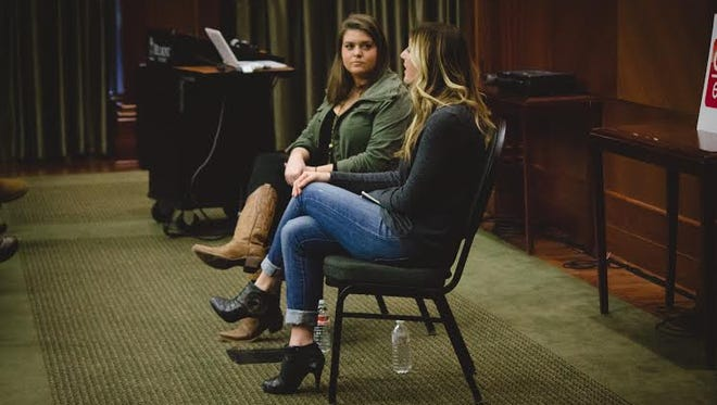 Kimberly Novosel, right, speaks to Belmont University students about entrepreneurship in the music business.