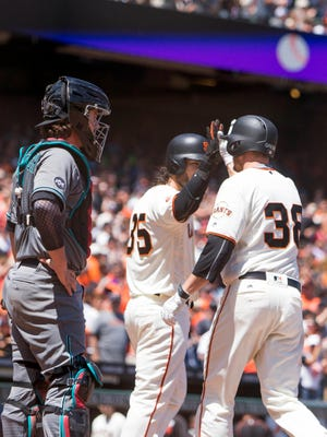 Jul 9, 2016: San Francisco Giants second baseman Grant Green (38) is congratulated by shortstop Brandon Crawford (35) after hitting a two run home run in the fourth inning in front of Arizona Diamondbacks catcher Tuffy Gosewisch (8) at AT&T Park.