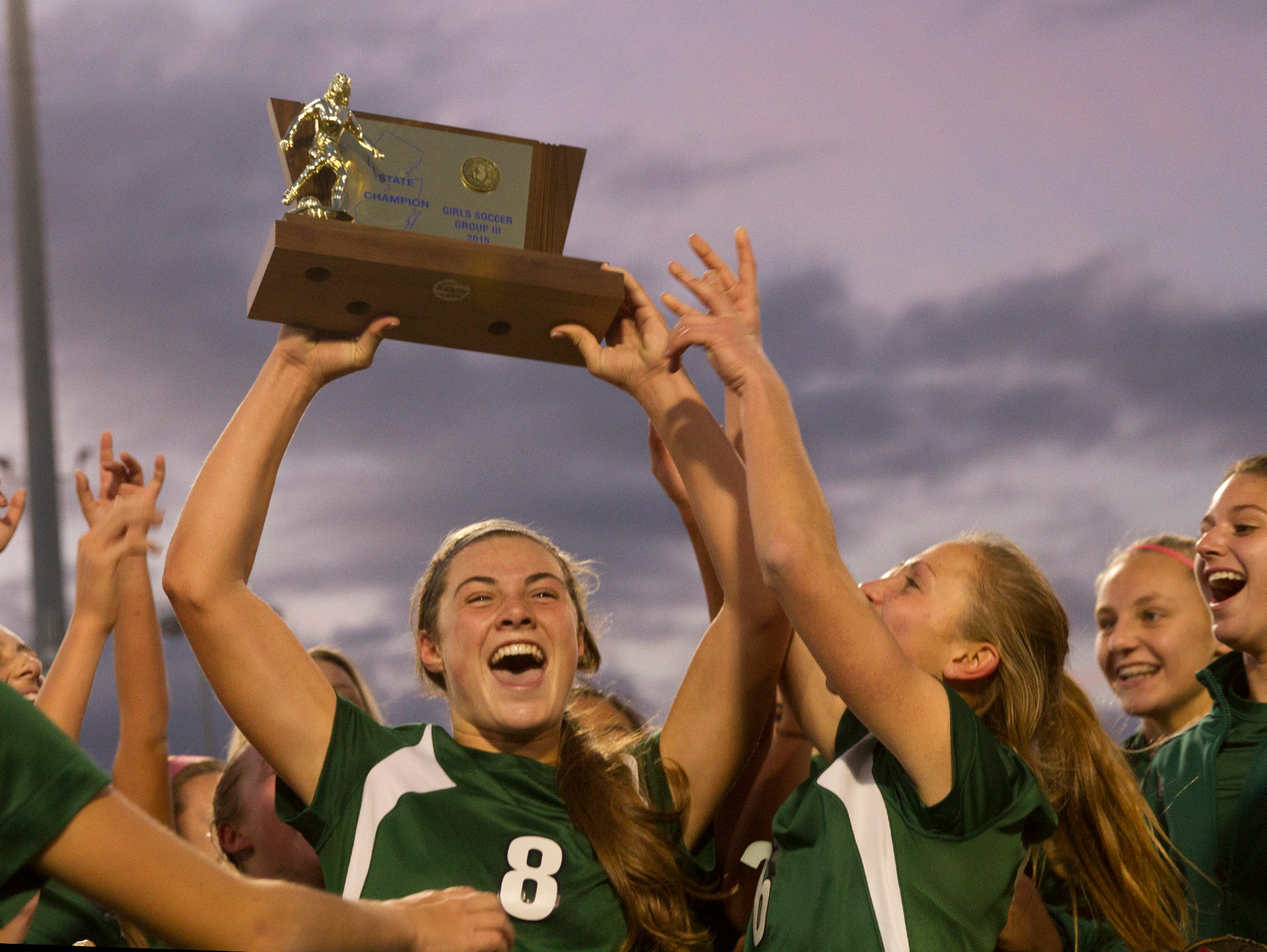 Colts Neck's Amanda Visco waves the championship trophy at fans in the stand after Colts Neck defeated Northern Highlands 1-0. Colt Necks Girls Soccer vs Northern Highlands in NJSIAA State Group III Championship at Kean University on November 21, 2015 in Union, NJ.
