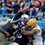 FILE - In this Nov. 8, 2015, file photo, Carolina Panthers' Cam Newton (1) reaches the ball over the goal line for a touchdown during the team's NFL football game against the Green Bay Packers in Charlotte, N.C. Newton has won The Associated Press NFL Most Valuable Player award in a landslide.