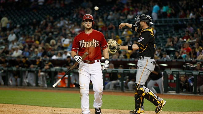 Diamondbacks' Chris Owings reacts to striking out in the bottom of the ninth with a runner on base against the Pirates at Chase Field in Phoenix, AZ on April 26, 2015.