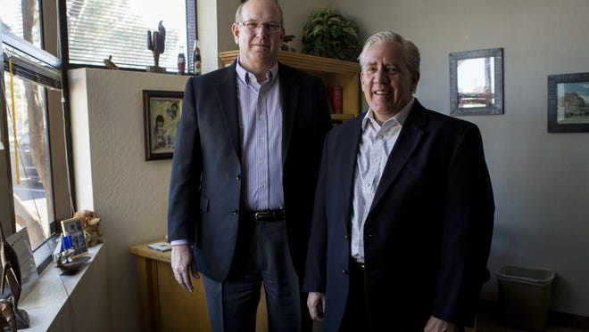 Mike Bradley, left, and Ben Wilson pose for a portrait at the ECD Systems headquarters in Tempe.