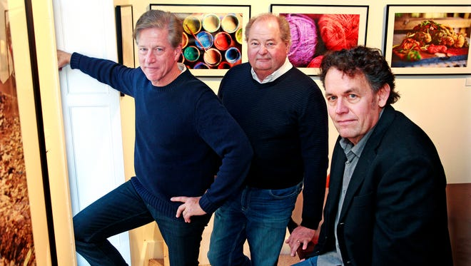 Michael De Boer (right),  co-founder of Harvest Strat, with business partners, Dean Potratz, (center) and Jason Klagstad in their office.