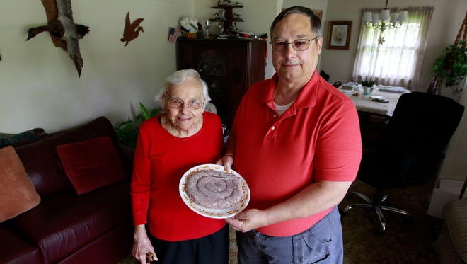 Michael Krass displays his traditional Polish sausage. His mother, Beverly Krass (left), taught him the recipe.