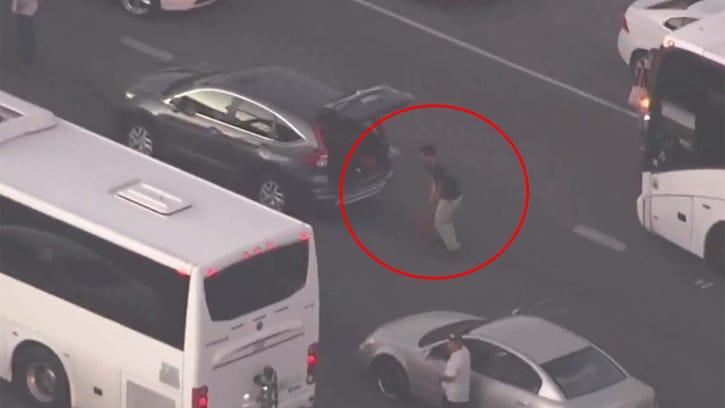 Dude practices dribbling in traffic jam