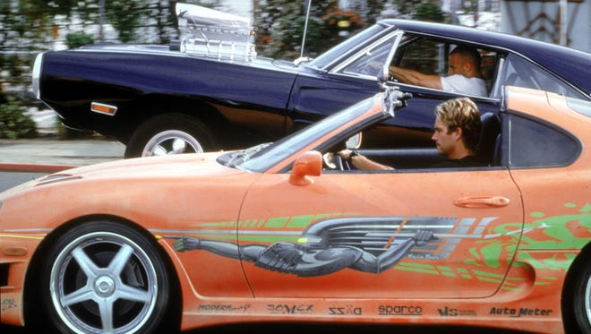 Paul Walker and Vin Diesel in a scene from 'The Fast and the Furious.'