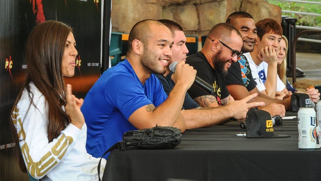 """Frank """"The Crank"""" Camacho, second from left, makes a lighthearted remark about meeting his weight class during a press conference at the Pacific Islands Club Resort in Tumon on  Wednesday, July 6. Camacho will be going up against contender Han Seul Kim in their welterweight bout at the Pacific X-treme Combat 54 mixed martial arts fights, scheduled for Friday, July 8."""