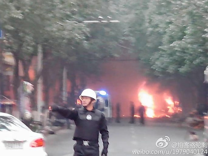 A photograph from the social media website Weibo shows a security officer working at the scene of an attack on May 22 at a market in Urumqi, Xinjian Uygur Autonomous Region, China. Thirty-one people were killed when a group of attackers drove vehicles into a crowded market, running over shoppers as they threw explosives.