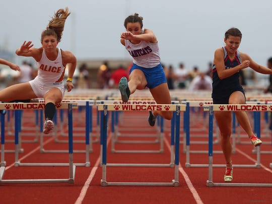 Alice runner Criselda Cruz, Gregory-Portland's Averie Griffith and Veterans Memorial's Amber Jones compete during the girls 100-meter hurdles at the District 30-5A track meet on Thursday, April 5, 2018 at Ray Akins Wildcat Stadium in Portland.
