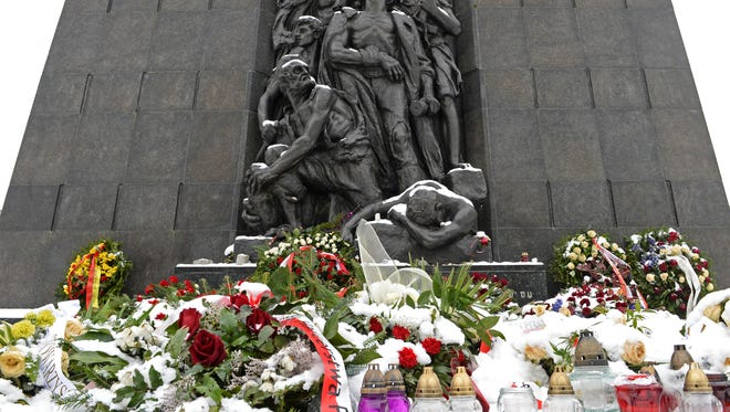 Snow covers flowers at the Warsaw Ghetto Uprising memorial in Warsaw, Poland, on Feb. 6, 2018.
