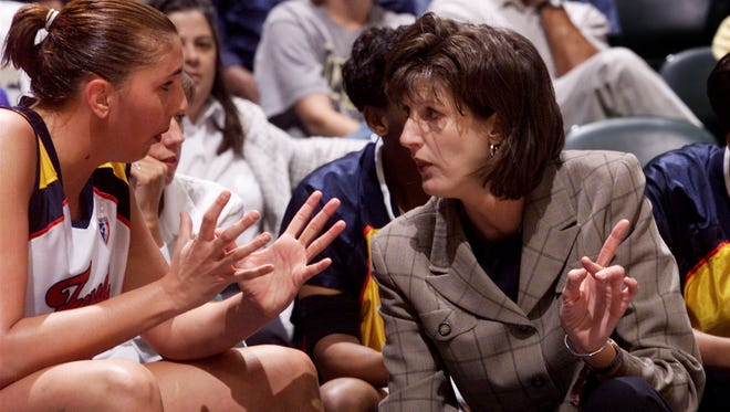 FILE == Indiana Fever coach Anne Donovan talks with center Kara Wolters on the bench during preseason play against Sacramento May 17.