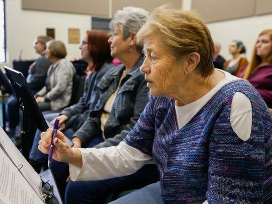 Nancy Shelton, right, takes notes during rehearsal