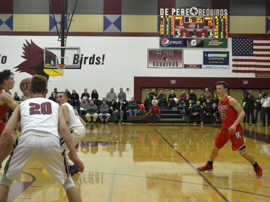 The De Pere Basketball Booster Club  hopes to pair the digital scoreboard in the De Pere High School field house with a new video board. The club is raising funds and seeking business partners to help with the cost of the board.