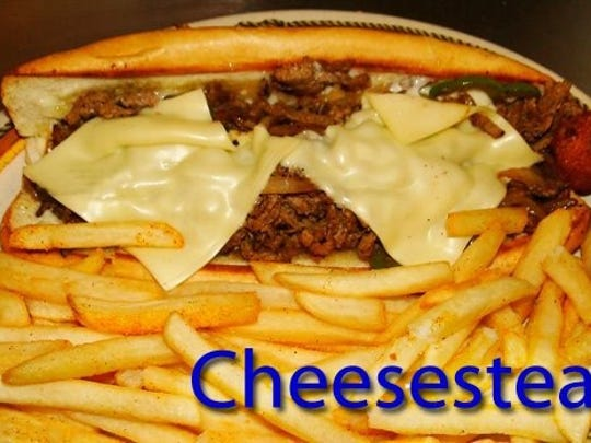 Cheesesteaks from the menu are shown.