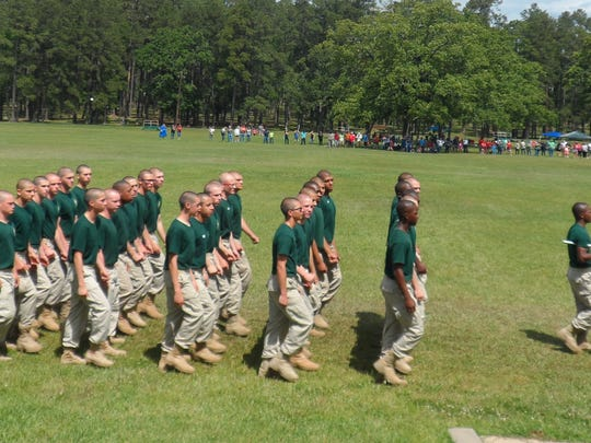 "Youth Challenge Program cadets march during a military-style ""pass in review"" ceremony Sunday before getting to spend time with friends and relatives during the YCP's Family Day at Camp Beauregard."