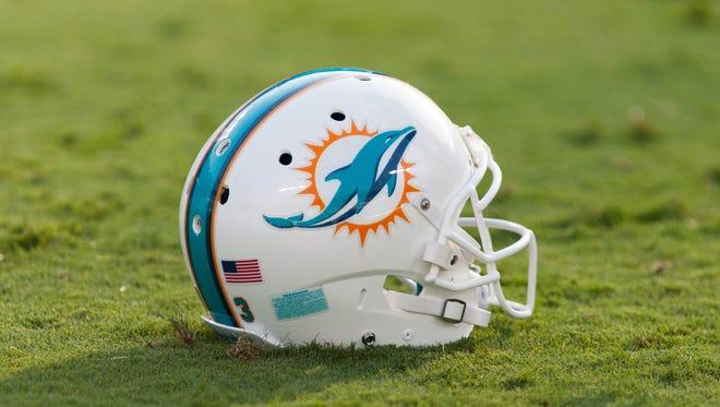A Miami Dolphins helmet on the turf.