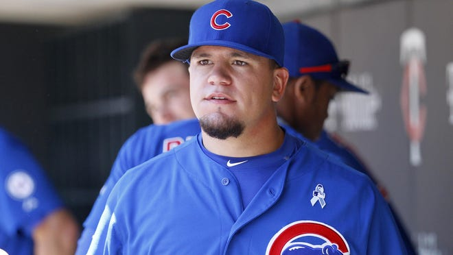 Chicago Cubs designated hitter Kyle Schwarber walks through the dugout before a baseball game against the Minnesota Twins in Minneapolis, Sunday, June 21, 2015. (AP Photo/Ann Heisenfelt)