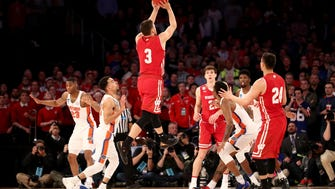 Wisconsin's Zak Showalter hits a three-pointer with 2.5 seconds left in regulation to tie the game, 72-72, against the Florida Gators on Friday night at Madison Square Garden.