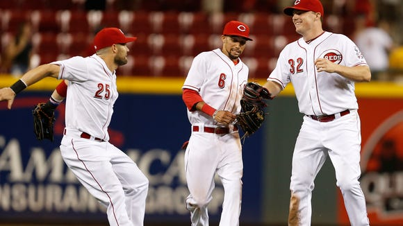 Reds outfielders (from left) Skip Schumaker, Billy Hamilton and Jay Bruce celebrate Tuesday's 8-3 win against the Giants at GABP.