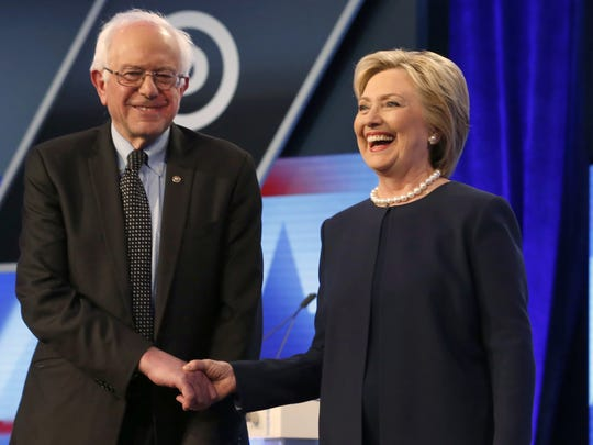 Democratic presidential candidates, Hillary Clinton and Sen. Bernie Sanders, I-Vt,  shake hands before the start of the Univision, Washington Post Democratic presidential debate at Miami-Dade College, Wednesday, March 9, 2016, in Miami, Fla. (AP Photo/Wilfredo Lee)