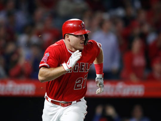 Los Angeles Angels' Mike Trout runs to first base after