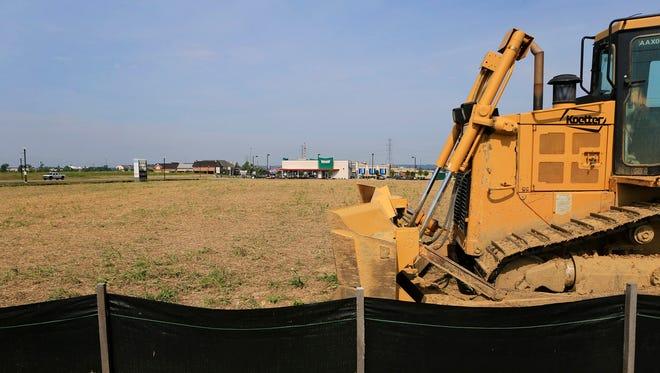 A bulldozer at a construction site.