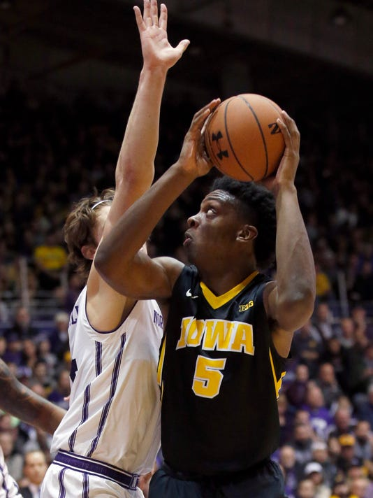 Iowa forward Tyler Cook, right, looks to the basket as Northwestern forward Gavin Skelly during the first half of an NCAA college basketball game Sunday, Jan. 15, 2017, in Evanston, Ill. (AP Photo/Nam Y. Huh)