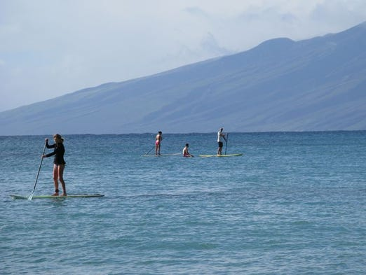 Stand-up paddleboarding is a popular activity in the