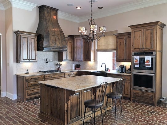 The kitchen has all modern appliances and amenities.