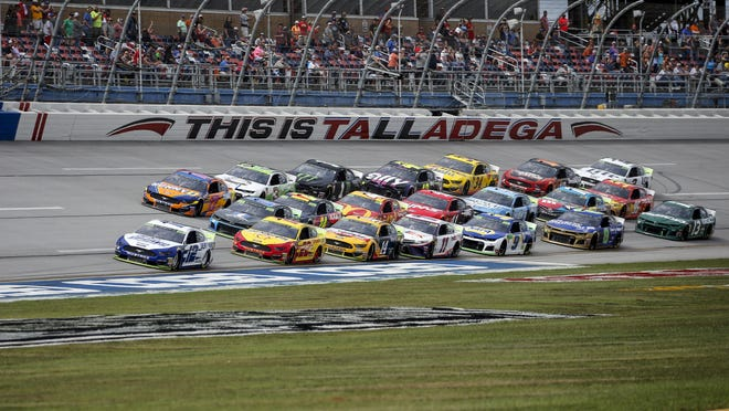 Ryan Blaney leads a pack of cars during a NASCAR race Oct. 14, 2019, at Talladega Superspeedway in Talladega, Ala.