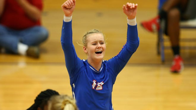 West Henderson's Malia Moore reacts after a point in the second set against Alexander Central during a playoff match at West.