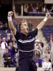 Todd Martin screams in celebration after defeating Carlos Moya in a five-set match of the fourth round of the 2000 US Open.