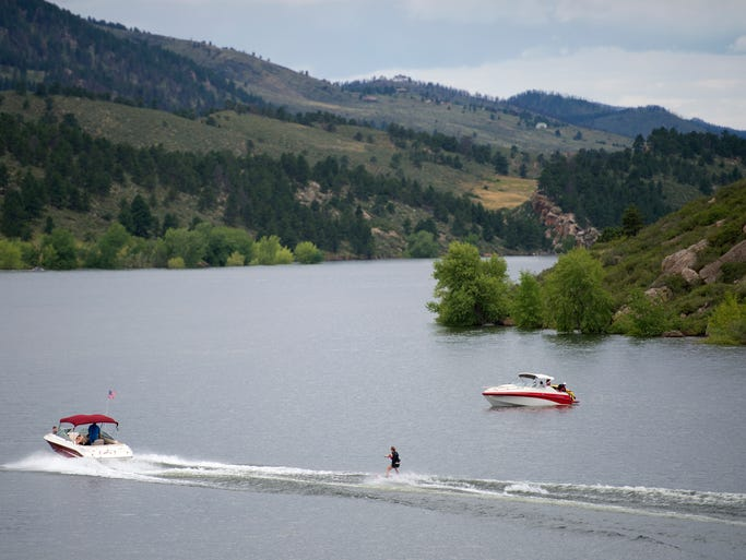 A boat pulls a water skier across Horsetooth Reservoir Tuesday, August 5, 2014. The Larimer County Natural Resources Department celebrates its 60th birthday this year.