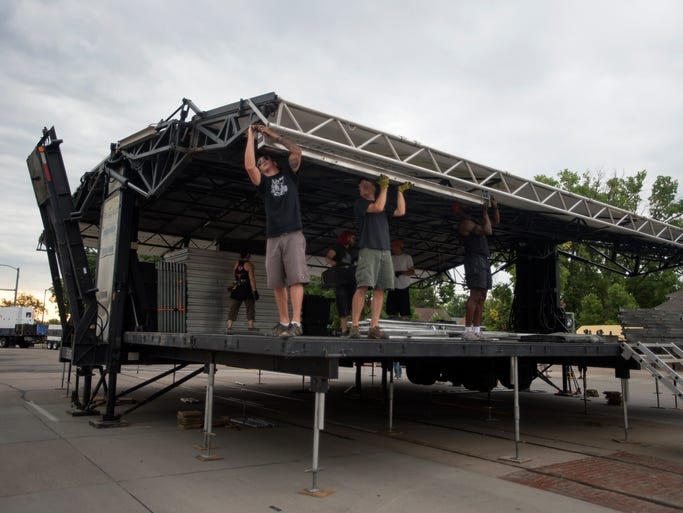 Workers set up the main stage for Bohemian Nights at NewWestFest on Mountain Avenue Thursday, August 14, 2014. The community, arts and music festival runs Friday to Sunday.