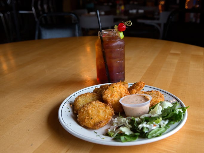 Fried green tomatoes with Swamp Water cocktail at Mo' Betta Gumbo in Loveland Monday, August 25, 2014.
