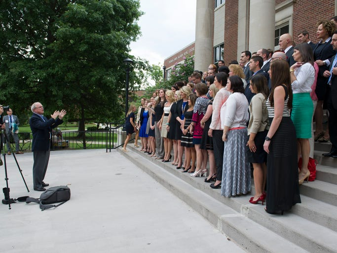 Nashville Area Chamber of Commerce CEO Ralph Schulz, left, talks to awards finalists before a group photo at the Nashville Emerging Leader Awards Thursday, July 31, 2014, at Lipscomb University in Nashville.