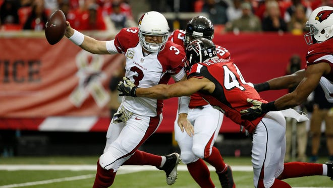 Nov 27, 2016; Atlanta, GA, USA; Cardinals quarterback Carson Palmer (3) is pressured by Falcons outside linebacker Vic Beasley (44) in the second quarter of their game at the Georgia Dome.