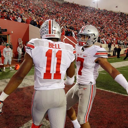 Ohio State's Vonn Bell (11) and Jalin Marshall celebrate