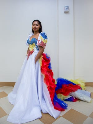 Nadia Pablo models a gown designed by Filipino couturier Ramon Santiago at the Filipino Community of Guam's August Board Meeting in the Guam Museum. This is one of the pieces that is available for purchase after the October 20 event.