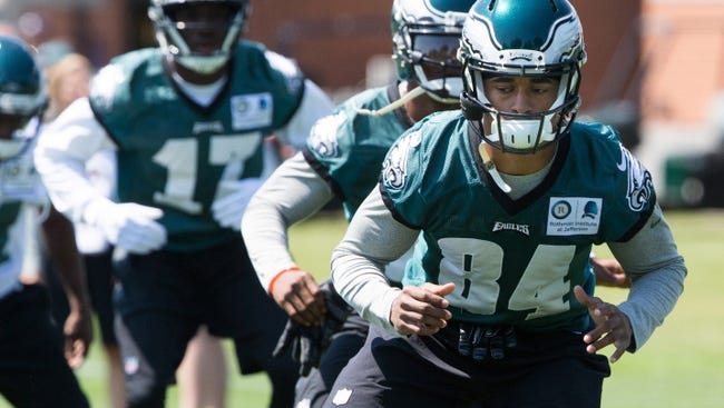 The Eagles receivers, shown during a minicamp in June, can expect a lot of hitting and tackling to the ground during training camp this season.