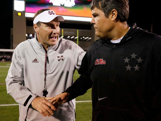 Mississippi State head coach Dan Mullen, left, and