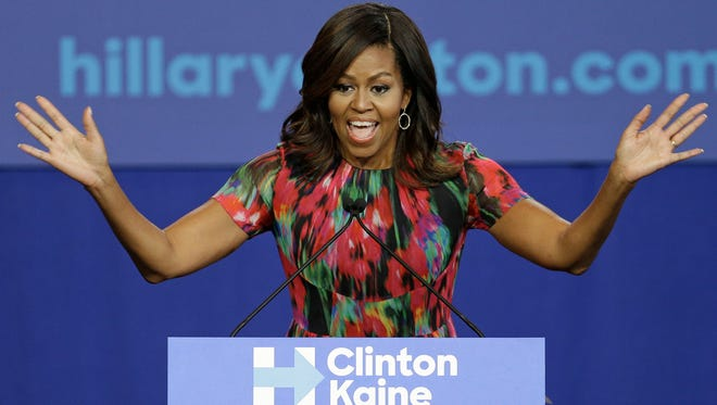 FILE - In this Oct. 4, 2016, file photo, first lady Michelle Obama speaks during a campaign rally for Democratic presidential candidate Hillary Clinton in Charlotte, N.C. Michelle Obama has emerged as the most valuable player of Campaign 2016.