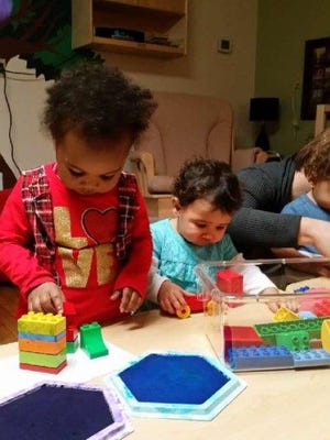 Early Head Start students  enrolled with the Community Progress Council play with blocks during the school day.
