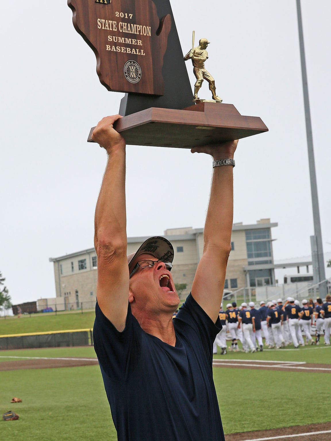 West Bend West head coach Bill Albrecht lost in the 2013 title game, but came back to state four years later and won the title with an undefeated Spartans team.