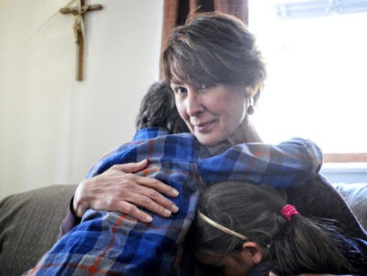 """In this file photo, Bernadette Reineberg is seen with the two grandchildren she's raising after her daughter Andrea Frick and Andrea's husband, Michael, died of drug abuse in July 2014. """"I can't define them as just two people who were addicted to a drug. They were more than that,"""" she said. She tells her story in a video at yorkdispatch.com."""