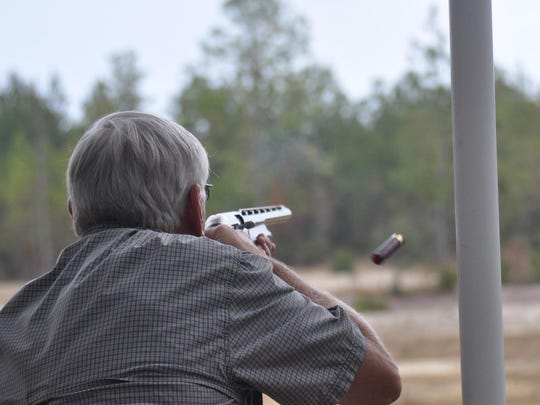 A Gulf Power employee participates in the 2014 annual Clay Shoot for America's Heroes designed to support local organizations that provide for the direct needs of active-duty and retired military service members and their families across Northwest Florida.