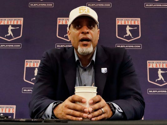 "FIEL - In this Feb. 19, 2017, file photo, Tony Clark, executive director of the Major League Players Association, answers questions at a news conference in Phoenix. Clark sadi Tuesday, Feb. 6, 2018, that the number of rebuilding teams and unsigned free agents in a historically slow market ""threatens the very integrity of our game."" Just 53 of 166 players who exercised their free agency rights last November had announced agreements entering Tuesday, down from 99 of 158 at a similar time last year. (AP Photo/Morry Gash, File)"